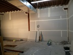 Second layer of sheetrock going up